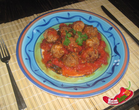 a plate of albondigas with tomato sauce