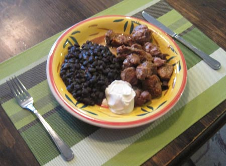 Carnitas michoacan plate with mexican black beans