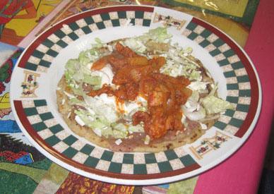a plate of memelas al pastor