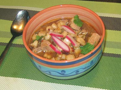 a serving of pozole rojo