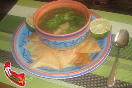 A bowl of pozole verde with totopos