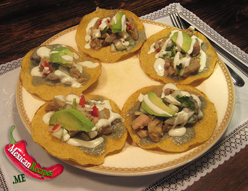 A plate with chicken tostadas
