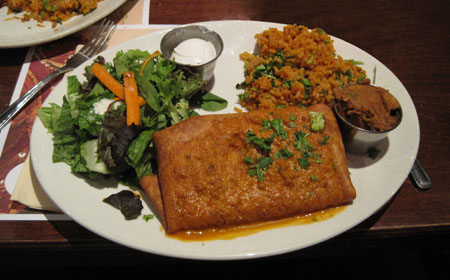 chimichanga served with salad and rice